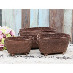 Flowerpot on lion feet antique rust