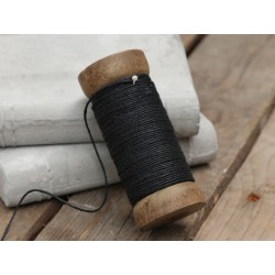 Jute ribbon on wooden spool